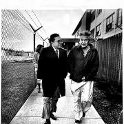 Senator Inouye walks with David Sohappy in jail