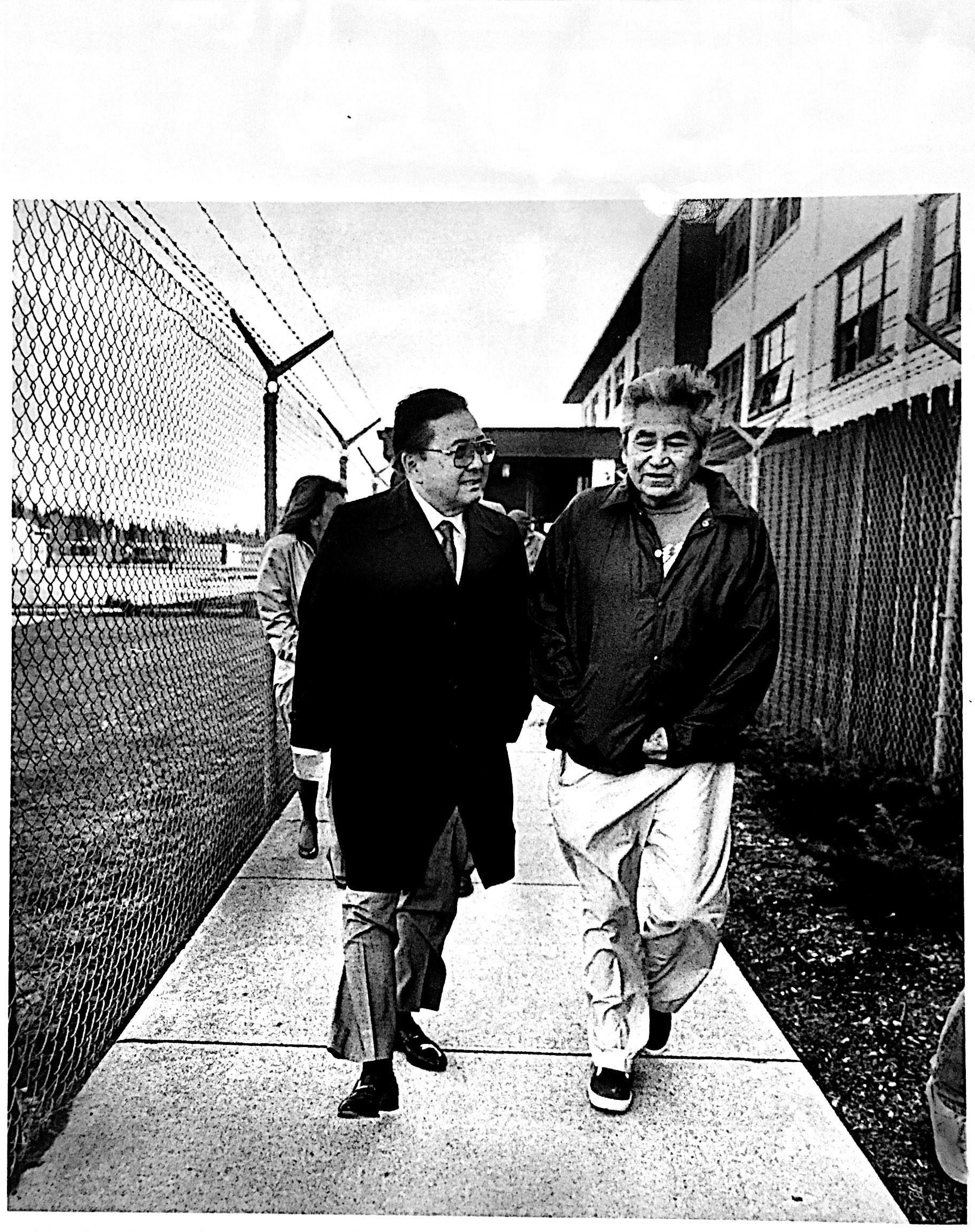 Senator Inouye walks with David Sohappy in jail